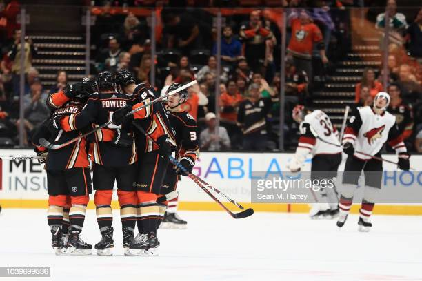 Cam Fowler is congratulated by Andrew Cogliano and Sam Steel of the Anaheim Ducks after scoring a goal as Darcy Kuemper and Jakob Chychrun of the...