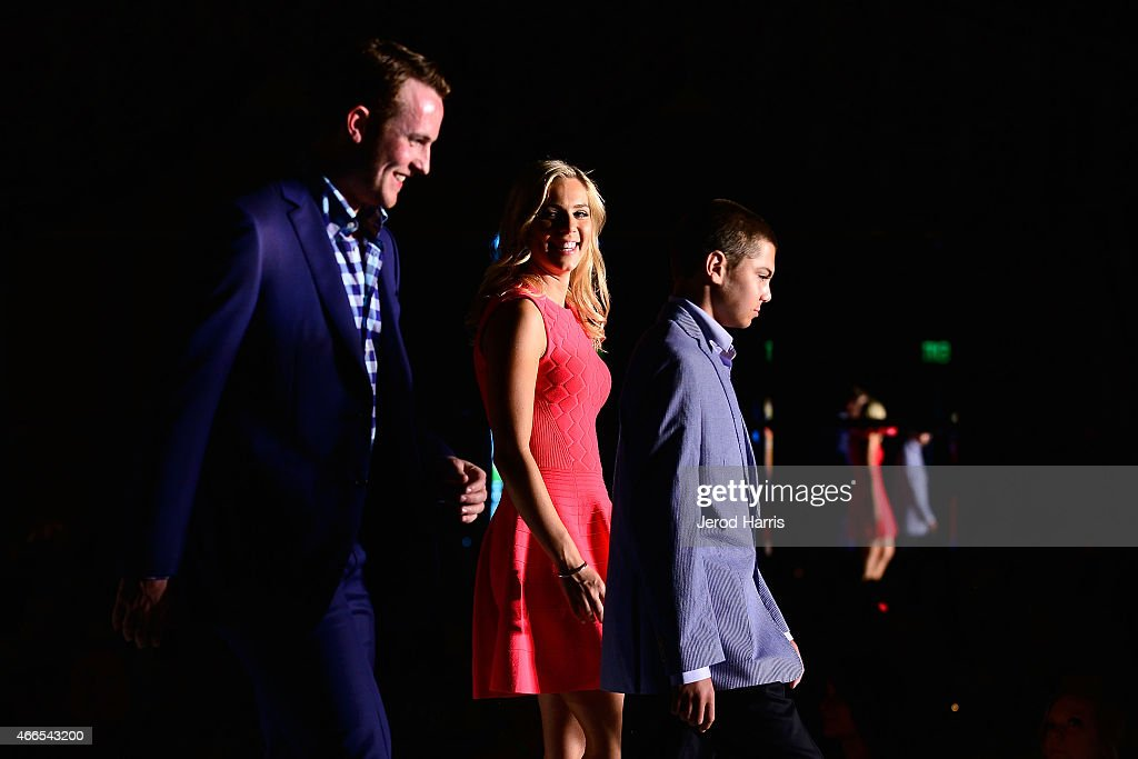 Cam Fowler, Jasmine Maggard and Mac Christman attend the Anaheim Lady Ducks Fashion Show Luncheon with Bloomingdale's South Coast Plaza on March 16, 2015 in Newport Beach, California.