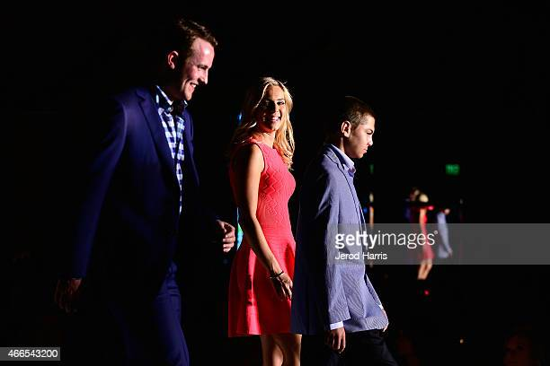 Cam Fowler Jasmine Maggard and Mac Christman attend the Anaheim Lady Ducks Fashion Show Luncheon with Bloomingdale's South Coast Plaza on March 16...