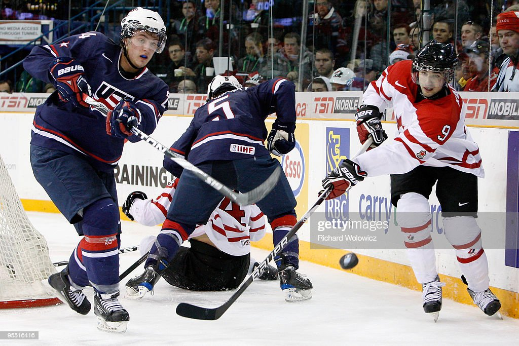 Cam Fowler #24 of Team USA clears the puck from Nazem Kadri #9 of Team Canada during the 2010 IIHF World Junior Championship Tournament game on December 31, 2009 at the Credit Union Centre in Saskatoon, Saskatchewan, Canada. Team Canada defeated Team USA 5-4 in a shootout.