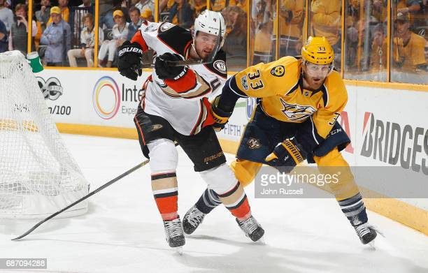 Cam Fowler of the Anaheim Ducks battles against Colin Wilson of the Nashville Predators in Game Four of the Western Conference Final during the 2017...
