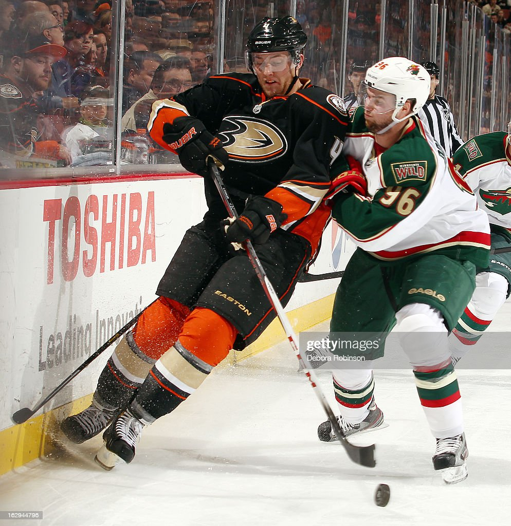 Cam Fowler #4 of the Anaheim Ducks battles for the puck against Pierre-Marc Bouchard #96 of the Minnesota Wild on March 1, 2013 at Honda Center in Anaheim, California.