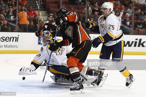 Cam Fowler of the Anaheim Ducks battles Marek Mazanec of the Nashville Predators for a loose puck during the third period of a game at Honda Center...