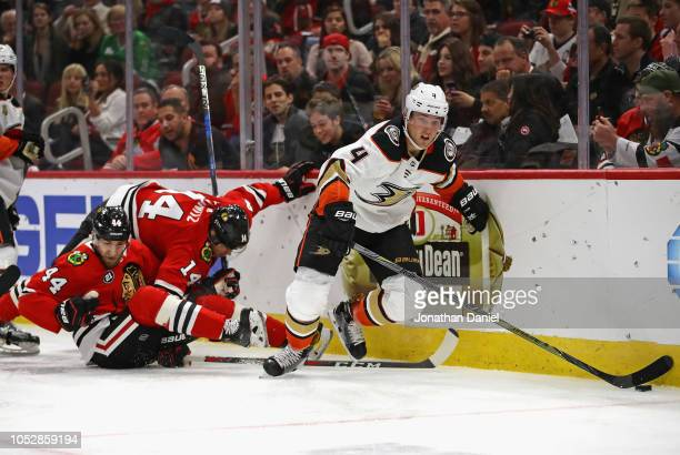 Cam Fowler of the Anaheim Ducks controls the puck as Chris Kunitz and Jan Rutta of the Chicago Blackhawks collide behind him at the United Center on...