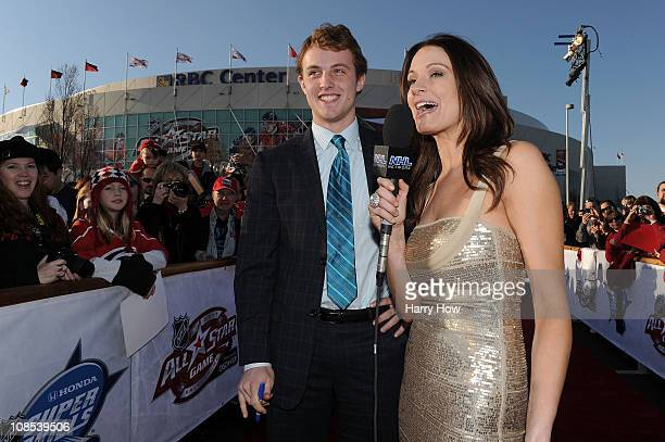 Cam Fowler of the Anaheim Ducks for Team Lidstrom speaks with Heidi Androl of the NHL Network as she arrives at the NHL AllStar red carpet part of...