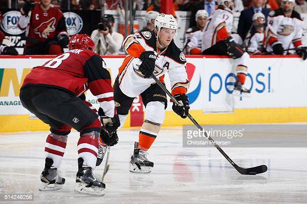 Cam Fowler of the Anaheim Ducks looks to pass during the NHL game against the Arizona Coyotes at Gila River Arena on March 3 2016 in Glendale Arizona...