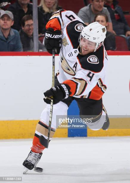 Cam Fowler of the Anaheim Ducks shoots the puck against the Arizona Coyotes during the second period of the NHL game at Gila River Arena on March 14...