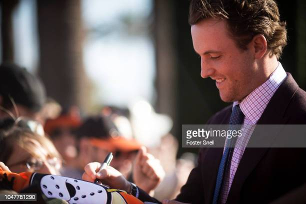 Cam Fowler of the Anaheim Ducks signs jerseys prior to opening night against the Detroit Red Wings on October 8 2018 at Honda Center in Anaheim...
