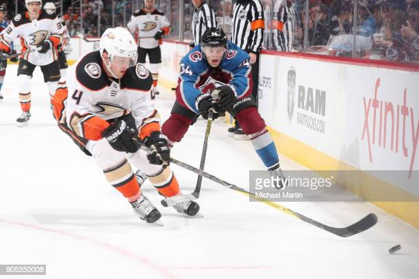 Cam Fowler of the Anaheim Ducks skates against Carl Soderberg of the Colorado Avalanche at the Pepsi Center on January 15 2018 in Denver Colorado The...