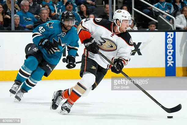 Cam Fowler of the Anaheim Ducks skates against Joel Ward of the San Jose Sharks during a NHL game at SAP Center at San Jose on November 26, 2016 in...
