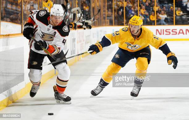 Cam Fowler of the Anaheim Ducks skates against Nick Bonino of the Nashville Predators during an NHL game at Bridgestone Arena on December 2 2017 in...
