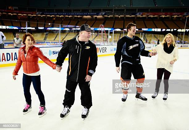 Cam Fowler of the Anaheim Ducks skates with his girlfriend with head coach Bruce Boudreau and his wife during the family skate after the team...
