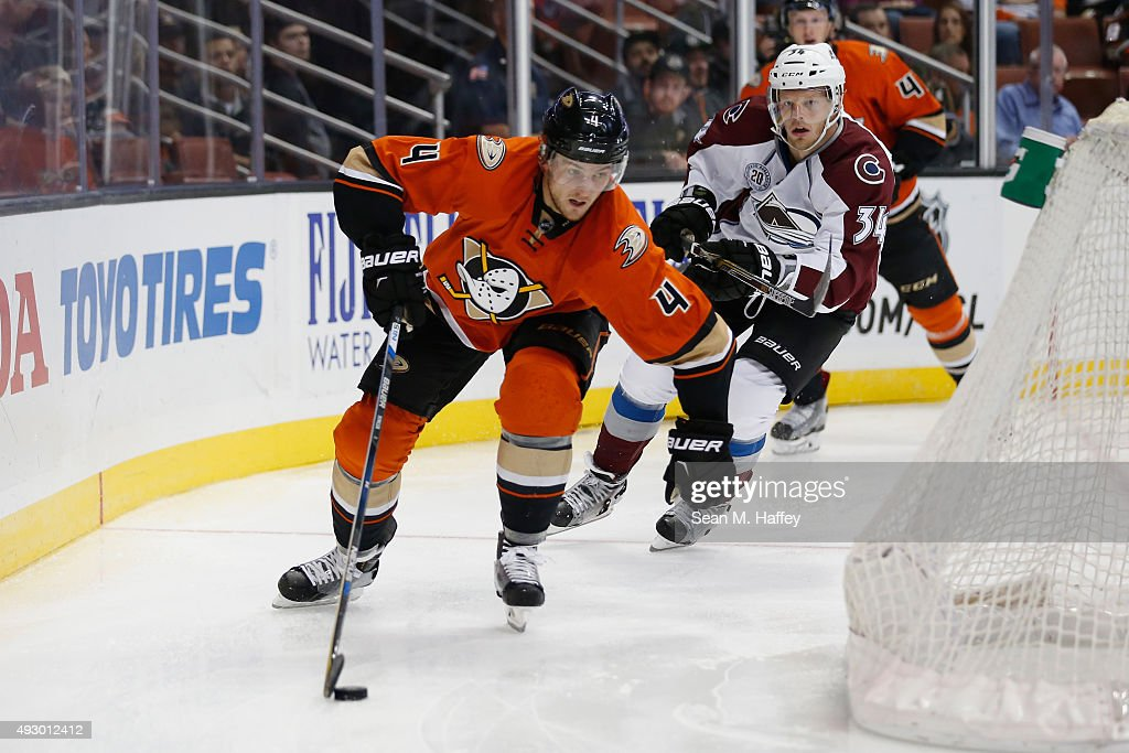 Cam Fowler #4 of the Anaheim Ducks, skates with the puck as Carl Soderberg #34 of the Colorado Avalanche pursues him during the first period of a game at Honda Center on October 16, 2015 in Anaheim, California.