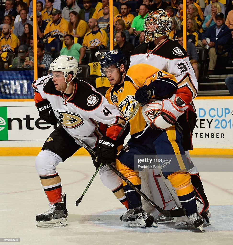 Cam Fowler #4 of the Anaheim Ducks stands in front of goalie Frederik Andersen #31 as he holds onto Viktor Arvidsson #38 of the Nashville Predators during the first period in Game Six of the Western Conference First Round during the 2016 NHL Stanley Cup Playoffs at Bridgestone Arena on April 25, 2016 in Nashville, Tennessee.