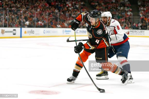 Cam Fowler of the Anaheim Ducks takes a shot on goal as Alex Ovechkin of the Washington Capitals looks on during the third period at Honda Center on...