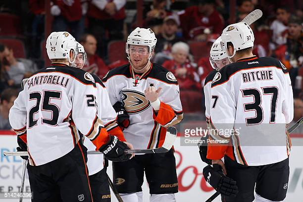 Cam Fowler of the Anaheim Ducks talks with Mike Santorelli dAnaheim Ducks Nick Ritchie during the NHL game against the Arizona Coyotes at Gila River...