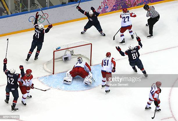 Cam Fowler of the United States celebrates with teammates after scoring a goal against Sergei Bobrovski of Russia in the second period during the...