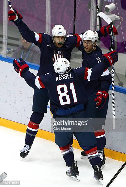Cam Fowler of the United States celebrates with teammates James van Riemsdyk and Phil Kessel of the United States after scoring a goal against Sergei...