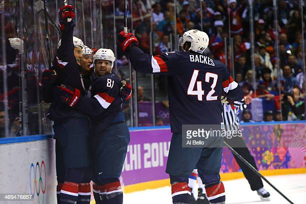 Cam Fowler of the United States celebrates with teammates James van Riemsdyk Phil Kessel and David Backes of the United States after scoring a goal...