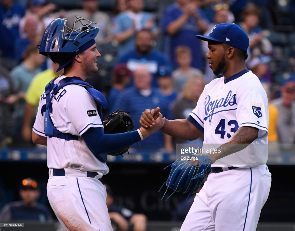 Cam Gallagher #36 of the Kansas City Royals and Neftali Feliz #43 of the Kansas City Royals celebrate a 9-1 against the Seattle Mariners win in game two of a doubleheader at Kauffman Stadium on August 6, 2017 in Kansas City, Missouri.