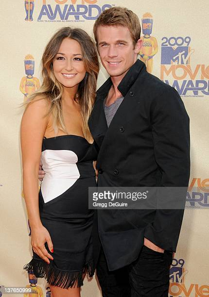 Cam Gigandet and Dominique Geisendorff arrive for the 2009 MTV Movie Awards at the Gibson Amphitheater in Universal City California on May 31 2009