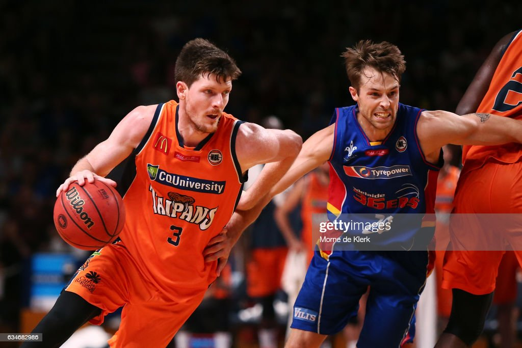 Cam Gliddon of the Cairns Taipans gets past Nathan Sobey of the Adelaide 36ers during the round 19 NBL match between the Adelaide 36ers and the Cairns Taipans at Titanium Security Arena on February 11, 2017 in Adelaide, Australia.