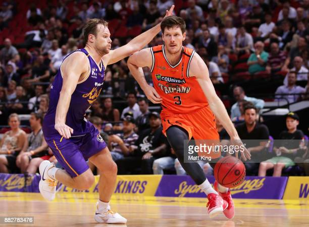 Cam Gliddon of the Taipans is challenged by Brad Newley of the Kings the round eight NBL match between the Sydney Kings and the Cairns Taipans at...
