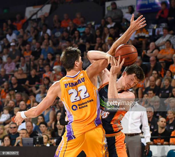 Cam Gliddon of the Taipans is fouled by Dane Pineau of the Kings during the round 17 NBL match between the Cairns Taipans and the Sydney Kings at...