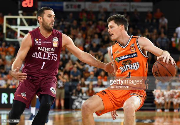 Cam Gliddon of the Taipans looks to get past Adam Gibson of the Bullets during the round 13 NBL match between the Cairns Taipans and the Brisbane...
