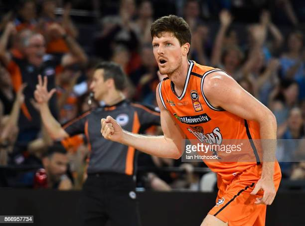 Cam Gliddon of the Taipans reacts after scoring a three point shot during the round four NBL match between the Cairns Taipans and the Adelaide 36ers...