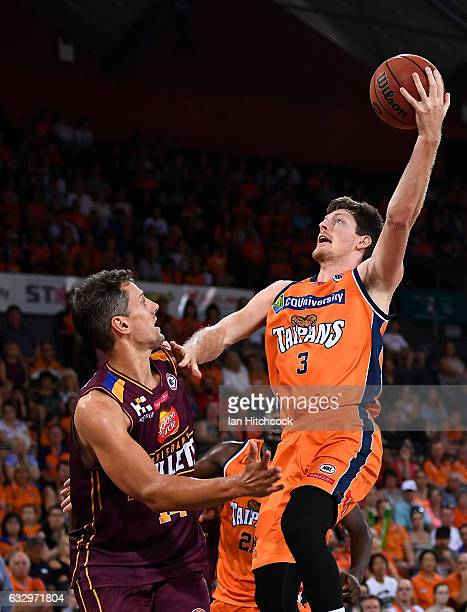 Cam Gliddon of the Taipans takes a shot over Daniel Kickert of the Bullets during the round 17 NBL match between the Cairns Taipans and the Brisbane...