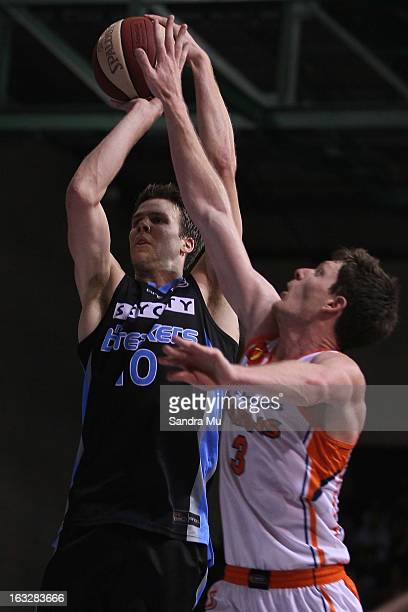 Cam Gliddon of the Titans defends Tom Abercrombie of the Breakers during the round 22 NBL match between the New Zealand Breakers and the Cairns...