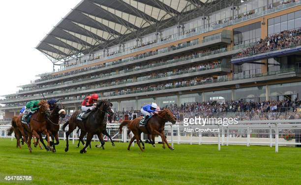 Cam Hardie riding Safety Check win The Fly London Southend Airport Handicap Stakes at Ascot racecourse on September 06 2014 in Ascot England