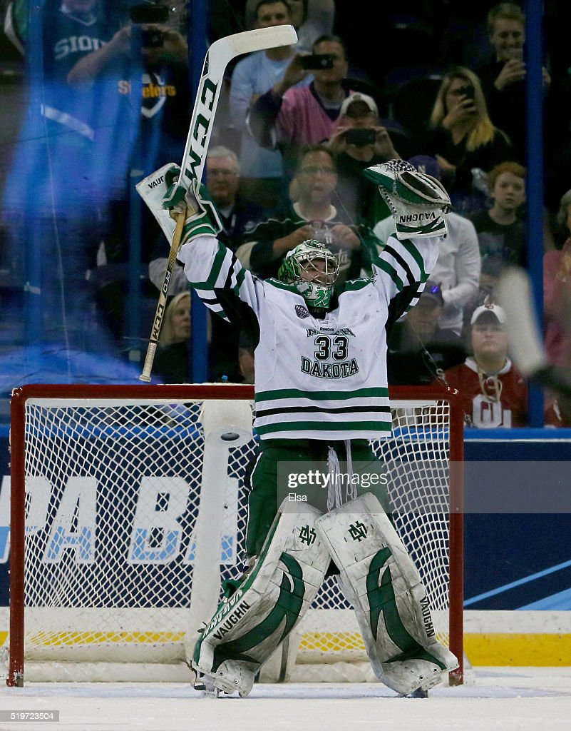 Cam Johnson #33 of the North Dakota Fighting Hawks celebrates the win over the Denver Pioneers during semifinals of the 2016 NCAA Division I Men's Hockey Championships at Amalie Arena on April 7, 2016 in Tampa, Florida.The North Dakota Fighting Hawks defeated the Denver Pioneers 4-2.