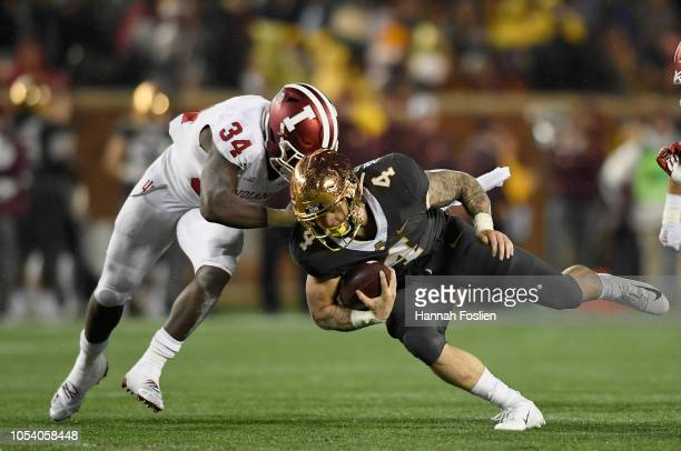 Cam Jones of the Indiana Hoosiers tackles Shannon Brooks of the Minnesota Golden Gophers during the third quarter of the game on October 26 2018 at...