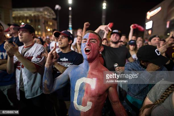 Cam Lathem of Ashville Ohio cheers on the Indians outside of Progressive Field during game 7 of the World Series between the Cleveland Indians and...