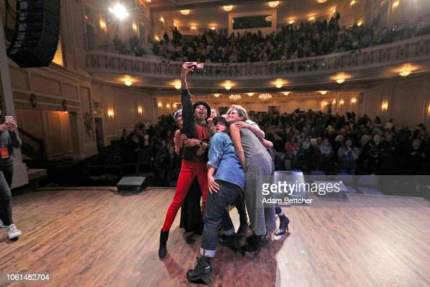Cam Luvvie Ajayi Maytha Alhassen Halima Aden Sabrina Jalees Priya Parker Ryan Weiss and Sophia Bush pose for a selfie with the crowd at the end of...