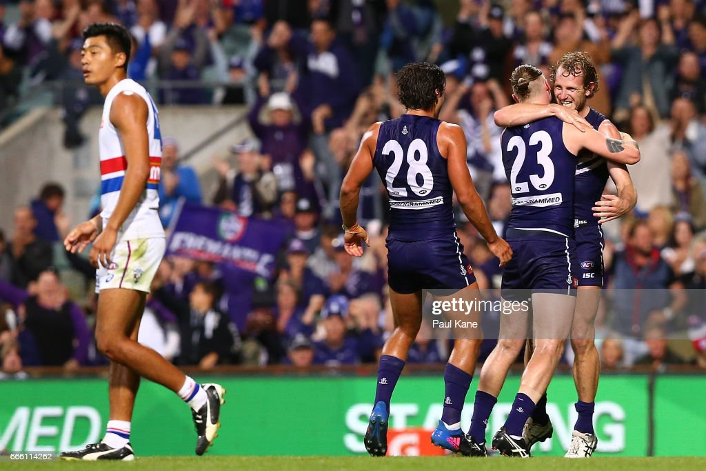 Cam McCarthy and David Mundy of the Dockers celebrate a goal during the round three AFL match between the Fremantle Dockers and the Western Bulldogs at Domain Stadium on April 8, 2017 in Perth, Australia.