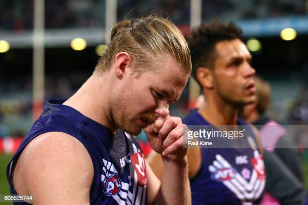 Cam McCarthy and Michael Johnson of the Dockers walk from the field after being defeated during the round 15 AFL match between the Fremantle Dockers...