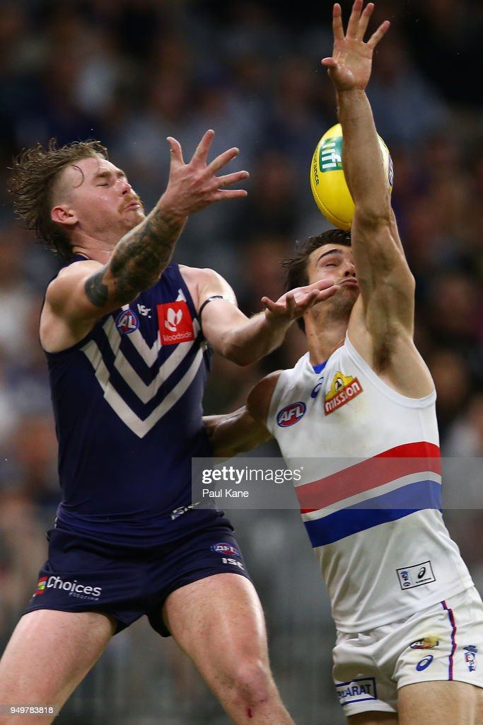 Cam McCarthy of the Dockers and Easton Wood of the Bulldogs contest for a mark during the round five AFL match between the Fremantle Dockers and the Western Bulldogs at Optus Stadium on April 21, 2018 in Perth, Australia.