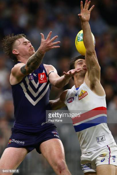 Cam McCarthy of the Dockers and Easton Wood of the Bulldogs contest for a mark during the round five AFL match between the Fremantle Dockers and the...