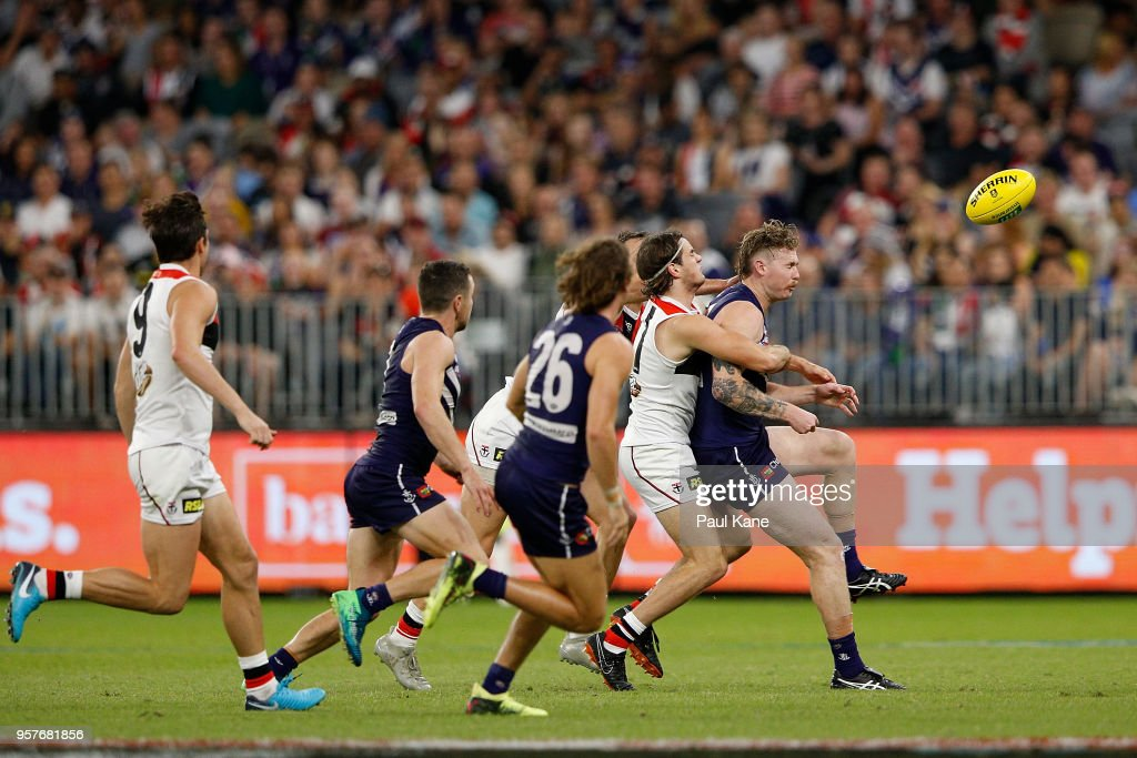 Cam McCarthy of the Dockers gets tackled by Hunter Clark of the Saints during the round eight AFL match between the Fremantle Dockers and the St Kilda Saints at Optus Stadium on May 12, 2018 in Perth, Australia.