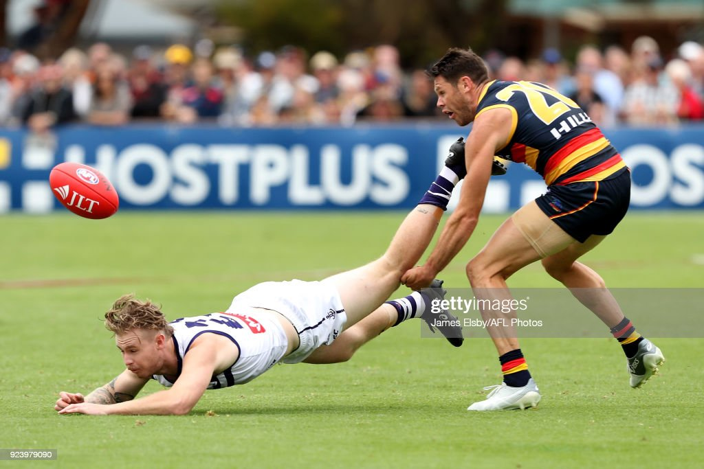 Cam McCarthy of the Dockers is tackled by Sam Gibson of the Crows during the AFL 2018 JLT Community Series match between the Adelaide Crows and the Fremantle Dockers at Strathalbyn on February 25, 2018 in Adelaide, Australia.
