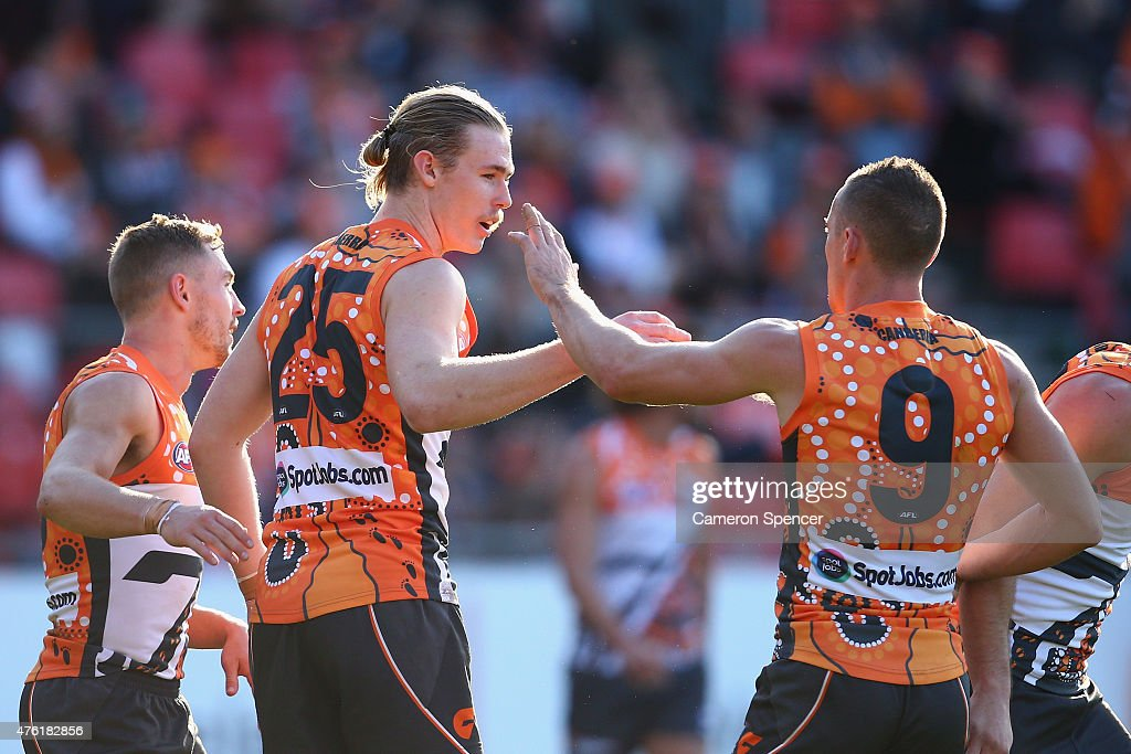 Cam McCarthy of the Giants celebrates kicking a goal during the round 10 AFL match between the Greater Western Sydney Giants and the Brisbane Lions at Spotless Stadium on June 7, 2015 in Sydney, Australia.