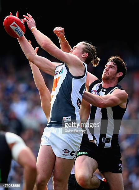 Cam McCarthy of the Giants marks infront of Tyson Goldsack of the Magpies during the round 11 AFL match between the Collingwood Magpies and the...