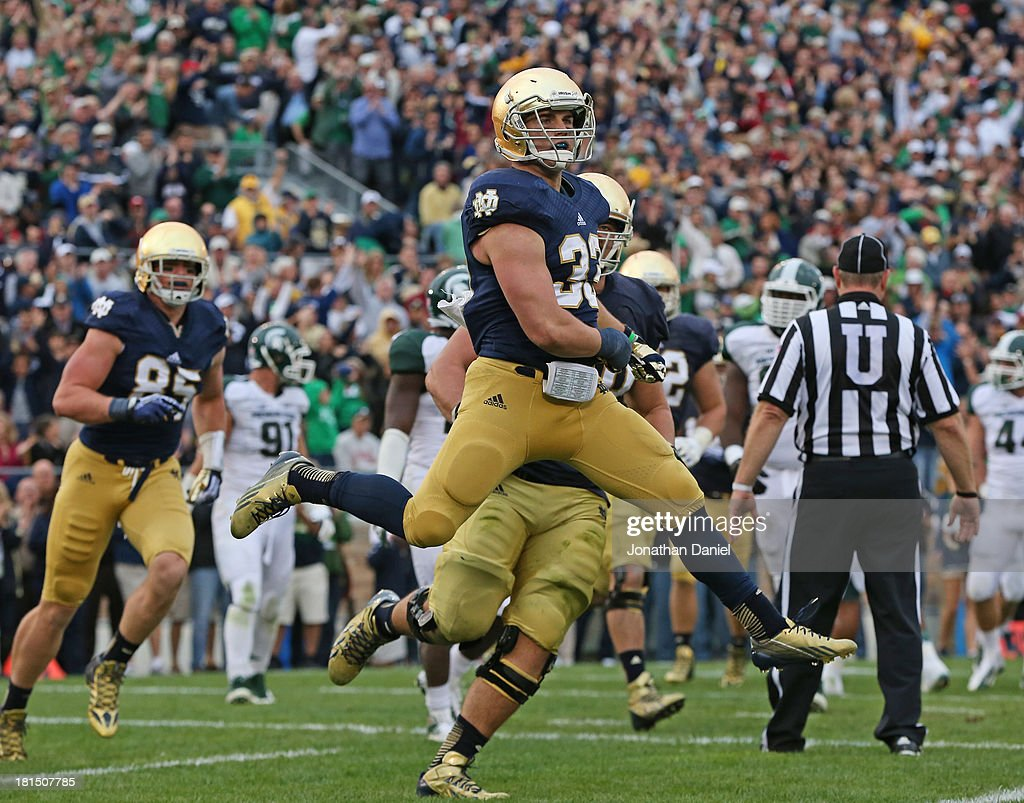 Cam McDaniel #33 of the Notre Dame Fighting Irish celebrates his game-winning touchdown against the Michigan State Spartans at Notre Dame Stadium on September 21, 2013 in South Bend, Indiana. Notre Dame defeated Michigan State 17-13.