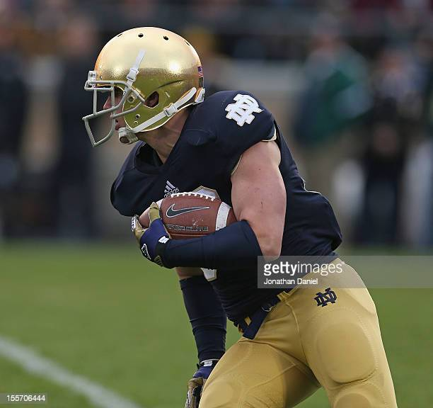 Cam McDaniel of the Notre Dame Fighting Irish runs against the Pittsburgh Panthers at Notre Dame Stadium on November 3 2012 in South Bend Indiana...