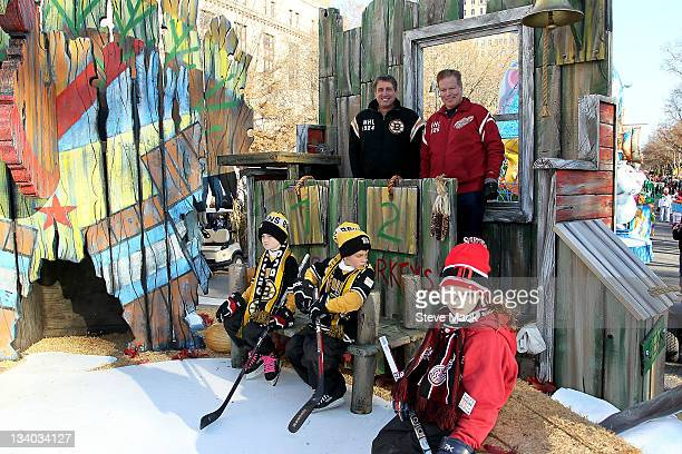 Cam Neely and Larry Murphy pose with skaters at NHL Discover's CoBranded Float 'Frozen Fall Fun' at the 85th Annual Macy's Thanksgiving Day Parade on...