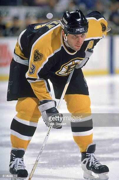 Cam Neely of the Boston Bruins lines up for the faceoff against the Buffalo Sabres at Memorial Auditorium on February 7 1996 in Buffalo New York The...