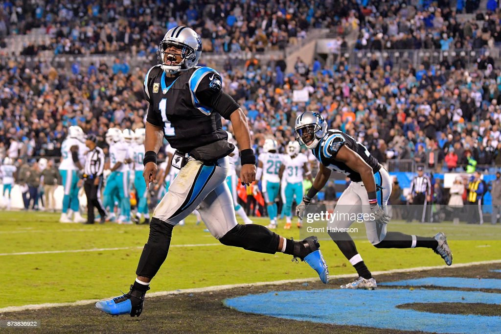 Cam Newton #1 and Devin Funchess #17 of the Carolina Panthers celebrate after a touchdown against the Miami Dolphins during their game at Bank of America Stadium on November 13, 2017 in Charlotte, North Carolina.